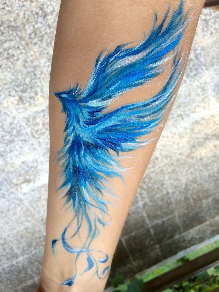 Phoenix Tattoofinder: Blue Ink Flying Phoenix Tattoo On Forearm