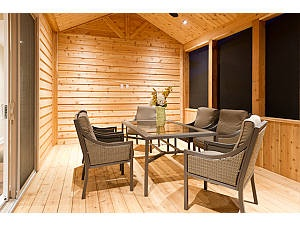 Cedar screened in porch would prefer completely encased in windows on all sides and comfy furniture