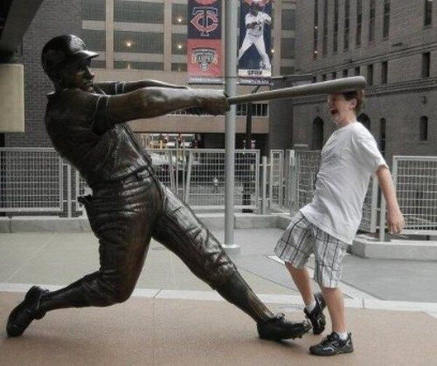 Fun with statues... only a few have done what we've all wanted to.