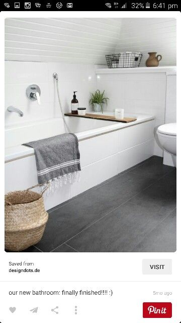 White bathroom concrete look tiles
