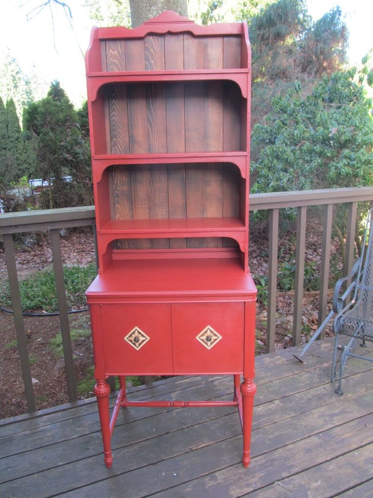 Old sewing cabinet paired with beat up wall shelves, and repurposed into one of a kind cabinet and hutch.  Finished off with reclaimed cedar on the back, wood veneer on the doors, and timeless red paint.