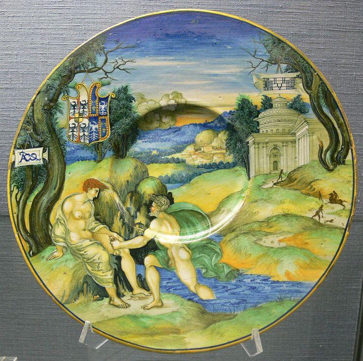 Nicola di Grabriele Sbraghe da Urbano (ca. 1480-1537/38) Service of Isabella d'Este (1474-1539), Plate with the legend of  Tiber and Manto, Italy, Urbino, ca. 1524-1525 Majolica a istoriato, painted in polychrome, D. 26,8 cm Berlin, Kunstgewebermuseum, 3816