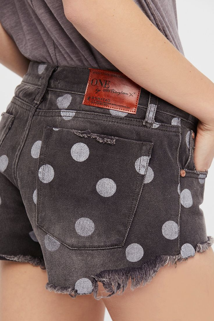 Polka-dot Cutoff Shorts | **Fit:** Runs true to size. Denim cutoff shorts in a low waist relaxed fit with a raw fringe curved hem. * Allover distressing * Five-pocket style and button fly