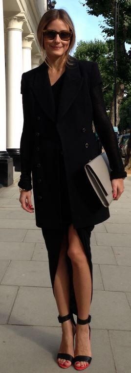 Who made Olivia Palermo's brown sunglasses, black long sleeve top, skirt, coat, skirt, and red ankle sandals?