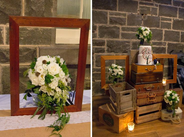 Vintage timber frame with bridal bouquet and bridesmaids bouquets stacked on crates and vintage trunk cake table. Naomi Rose Floral Design