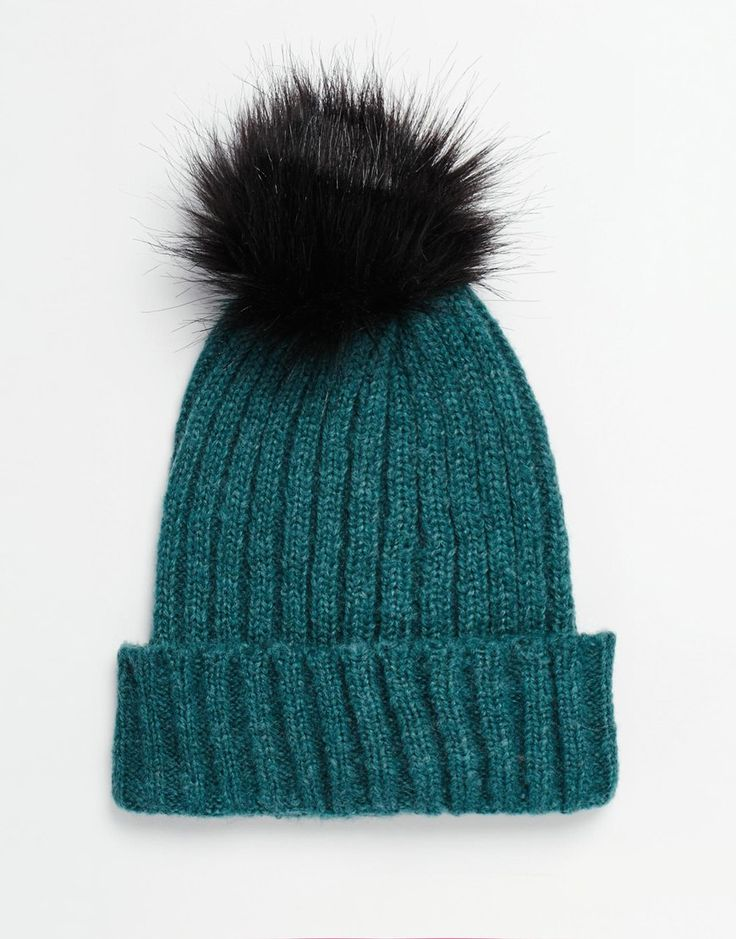 Pom-pom beanies will have you winning at winter