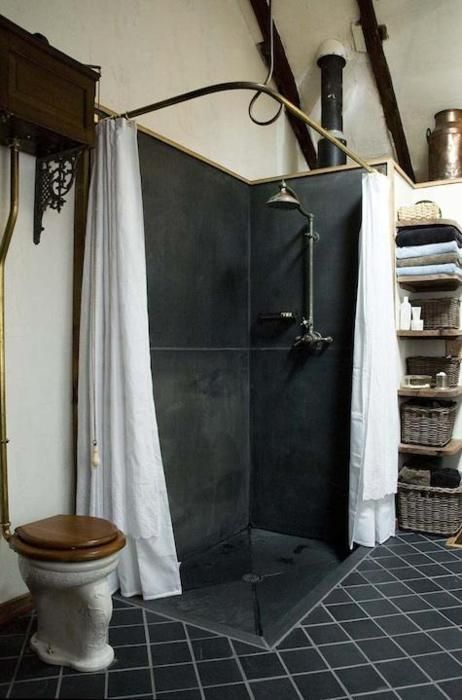 Black shower with over-sized / large tile - Antique toilet - White linen shower curtain