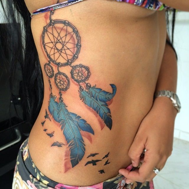 stunning dream catcher tattoo with blue teal color feathers