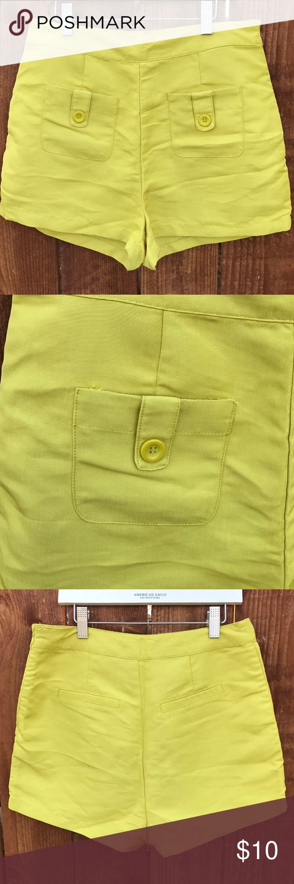 """Forever 21 Neon Yellow Shorts High waist shorts in neon yellow with side zipper for easy access, great condition. Fabric is NOT stretchable.  Rise: 14"""" Inseam: 2"""" Waist: 14.5"""" Forever 21 Shorts"""