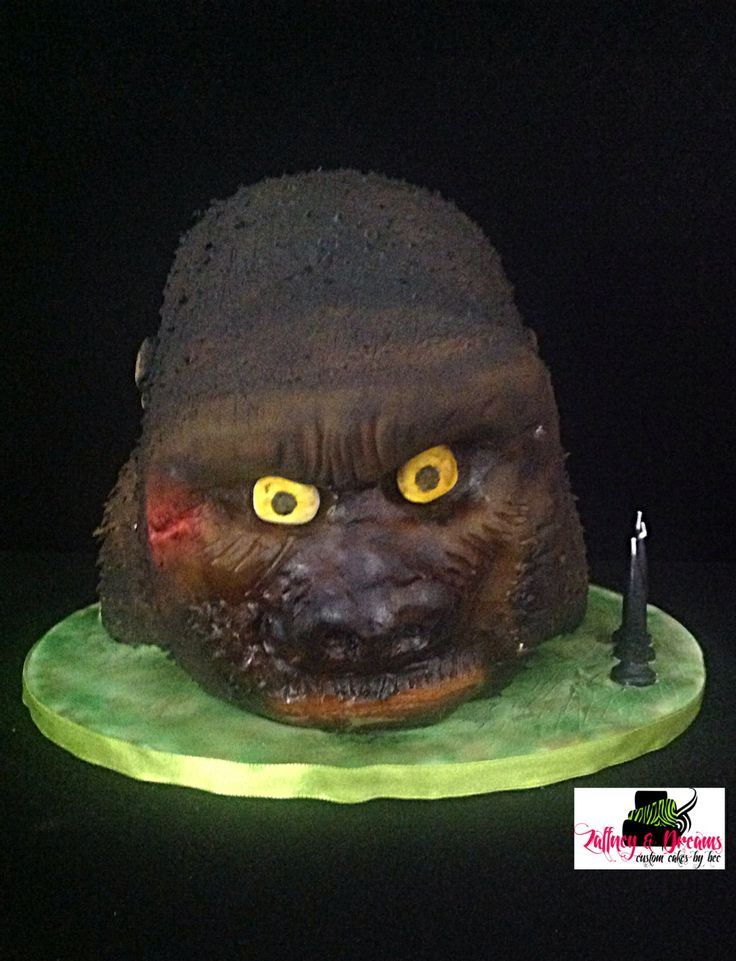 Kin Kong head. Constructed using strawberry white choc mudcake, white chocolate ganash. Modelling chocolate, fondant and airbrushed. All edible.