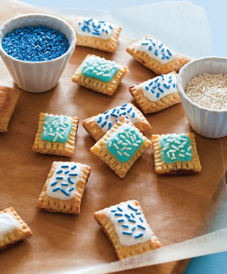 Mini Pop Tarts: 2 c all-purpose flour 1/4 t baking powder 1/4 t salt 3/4 c cold unsalted butter, cut into cubes 1/4 c cold cream cheese, cut into cubes 2 T buttermilk Fruit Filling: 1 c chopped strawberries 1/2 c blueberries 1/2 c granulated sugar 2 T honey S'mores filling: 3/4 c Nutella 3/4 c marshmallow crème  Royal icing: 1 egg white 11/4 c powdered sugar 1 t vanilla