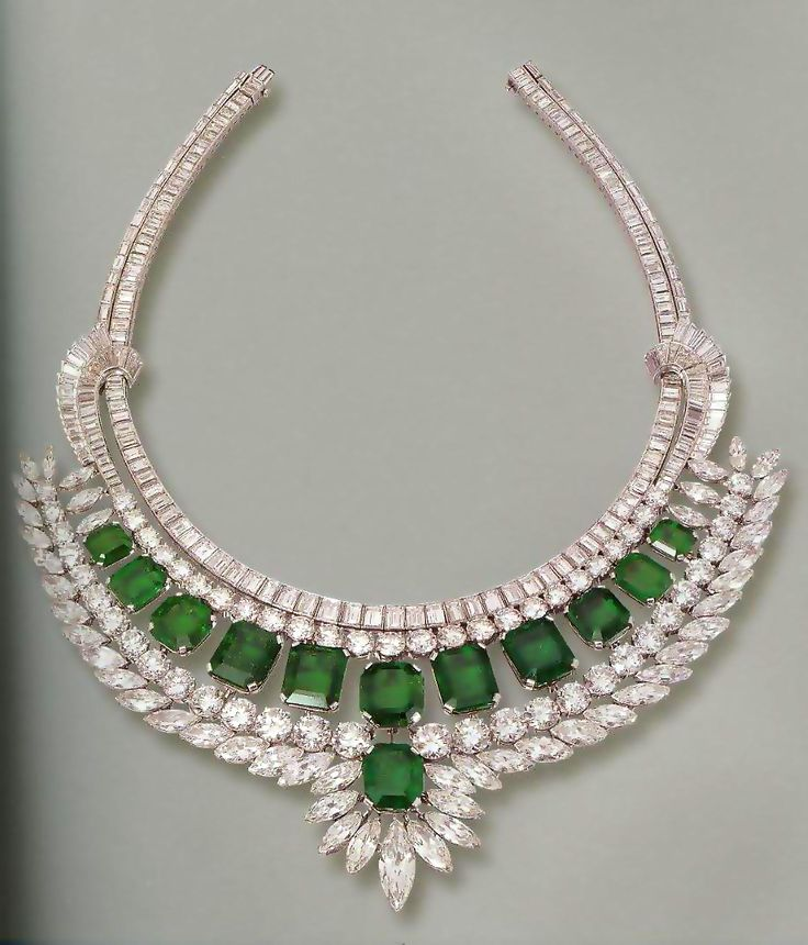 A Harry Winston emerald and diamond necklace, circa 1955, set with 12 emerald-cut emeralds weighing some 107 carats, and 341 marquise-shaped, round and baguette diamonds weighing some 153 carats,. The 12 emeralds were originally part of a necklace bought by Harry Winston from the Maharaja of Indore, Yashwant Rao Holkar.