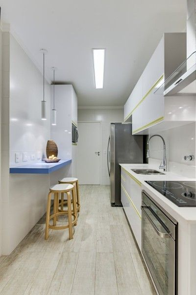 Sleek apartment kitchen styling - using floor tiles that look like timber