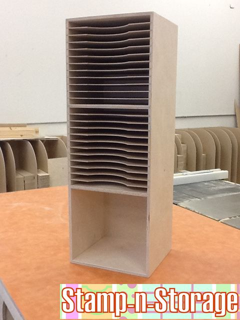 Three-Tier Paper Holder.  24 slots for 12x12 scrapbook paper and a perfect spot for a basket or other items.
