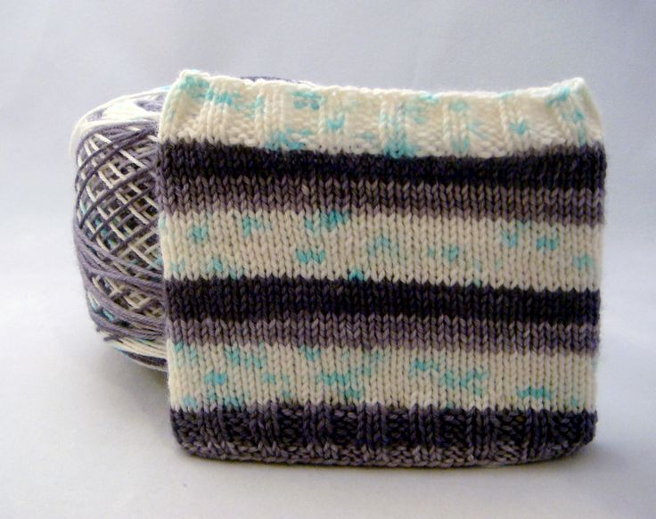 """Night Gathers is a self striping version of """"And now my watch begins"""" which was a variegated yarn in my October club. This yarn will stripe: 4 rows ghost grey 4 rows crow black 8 rows speckled ice  **Swatch is knit in the round on 2.5mm needles over 64 sts to mimic the standard sock size** ..."""