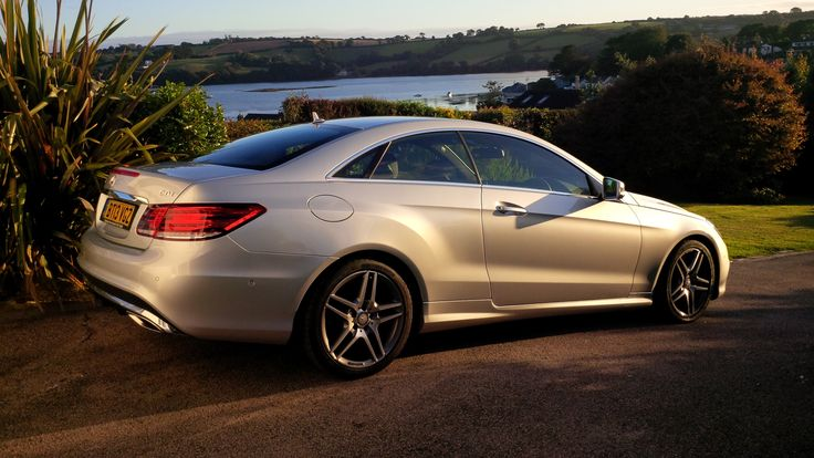 Mercedes E Class Coupe AMG Sport sunbathed off the coast of Cornwall