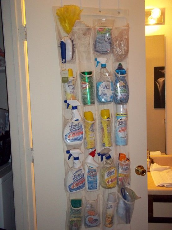 organize cleaning supplies with a shoe organizer...genius. I have a strange closet in my kitchen that has the hot water heater. Nothing will fit in it. Until now!