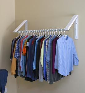 QuikCloset Clothes Storage Solution - wall-mounted folding hangers and rod