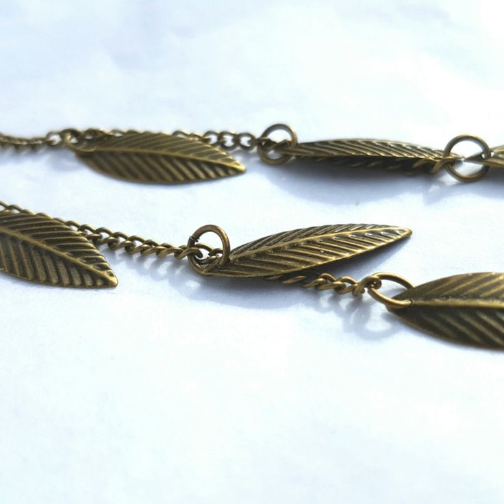 Newly listed earrings matching our delicate rustic bronze long necklace with leaf charms