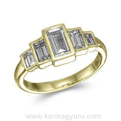 Modern öt köves gyémánt gyűrű. 18K sárga arany foglalatban összesen 1,20ct súlyú, G/Si1 minősített emerald csiszolású gyémántokkal. A súlya kb. 3,20gr.