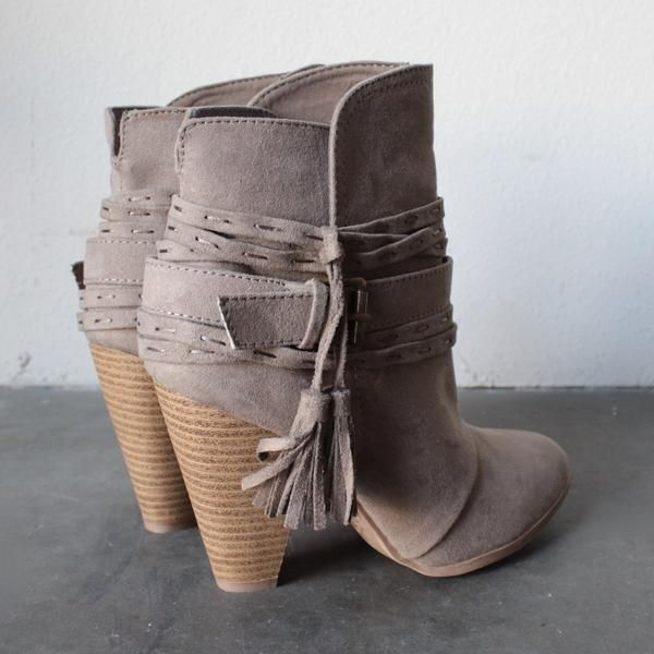 """A striking suede bootie with a stacked block heel. This bootie is as versatile as it is elegant.  How it fits:  Shaft: 5.5"""" Opening: 10"""" Heel: 3.75"""" Platform: 0.25""""  Fabric & care:All man made materials / imported"""