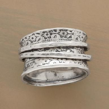 "Two spinning rings soar on a sterling silver carpet of flowers, oxidized to reveal leaf and petal details. Sundance exclusive. Whole sizes 5 to 9. 1/2""W."