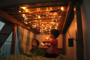 Bunk Bed Fort with lights. I did this today. Just tucked sheets up under the mattress on top. Totally awesome!