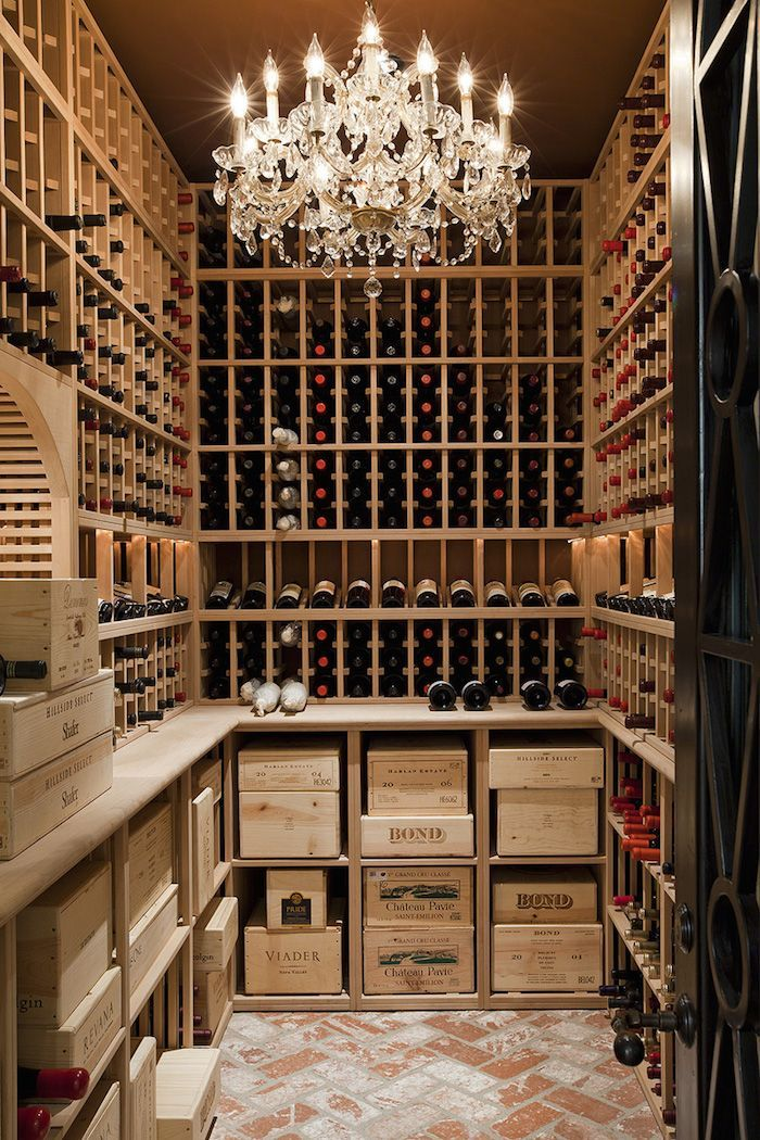 What an amazing wine cellar … from the sparkling chandelier to the raw wood shelving, rustic...
