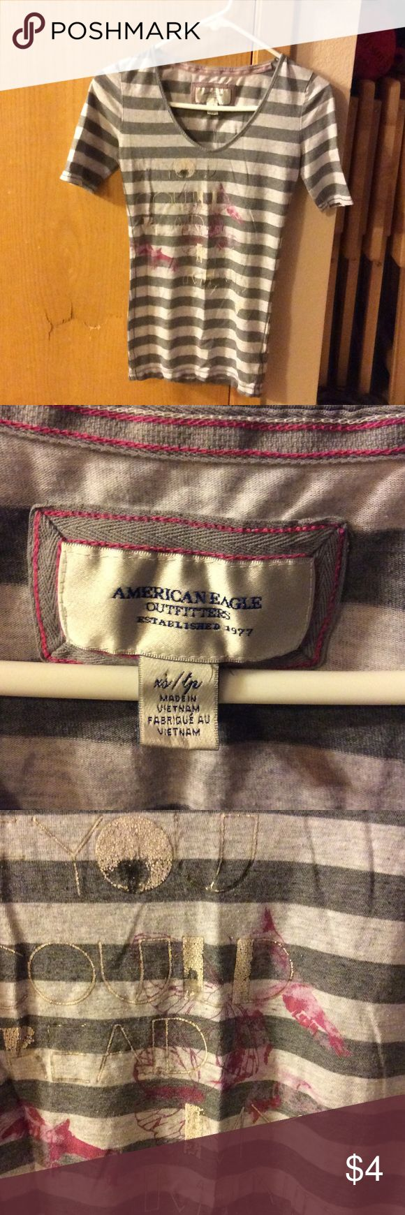 American Eagle Outfitters Tshirt, Size XS This shirts does have some life left in it and it is in good condition. The writing on the front is wearing off. The only thing wrong with the shirt. American Eagle Outfitters Tops Tees - Short Sleeve