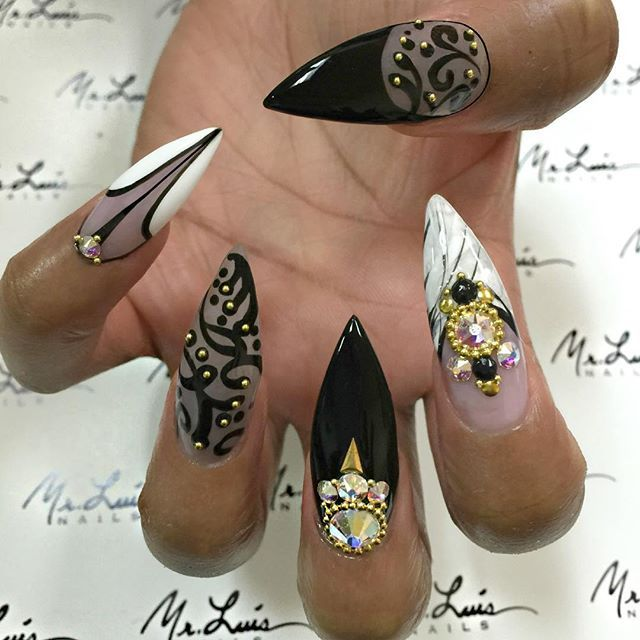 Black and white talons with gold and stones