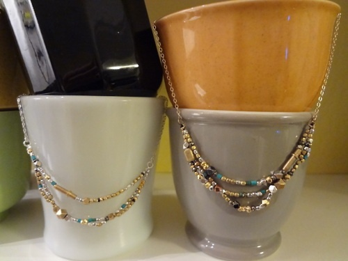 A pair of delicate draped necklaces of turquoise, sterling, brass, pyrite and more- one on sterling chain the other on goldfill.