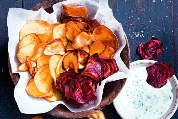 Gather up the best of winter's root vegetables, slice thinly and rethink what make a great chip. Served with this tangy dip, it is the perfect complement to a warm cosy catch up with friends or shared watching Friday night football.