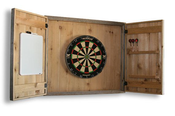 For sale is a wall-mounted dart board cabinet made from reclaimed fence boards. With storage for up to 12 darts, a large overthrow area and a chalkboard scoreboard (not shown), this beautiful cabinet will be the center of attention in your game room, garage, or patio. Due to the