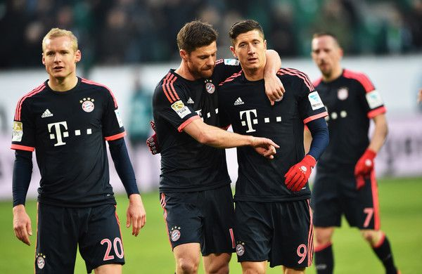 Robert Lewandowski of Muenchen celebrates with Xabi Alonso during the Bundesliga match between VfL Wolfsburg and FC Bayern Muenchen at Volkswagen Arena on February 27, 2016 in Wolfsburg, Germany.