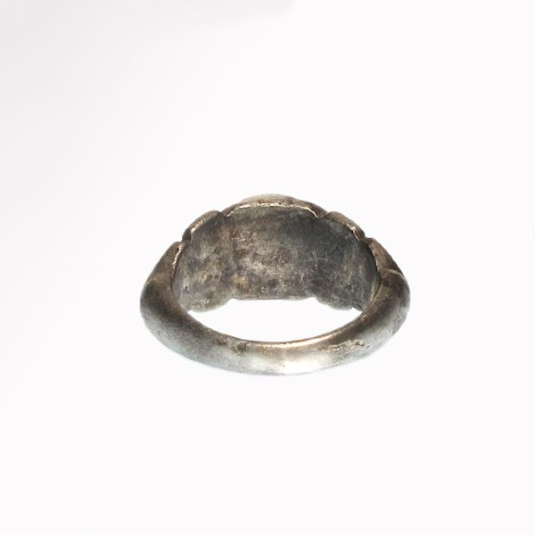 Roman Silver and Cornelian Ring with Eros, c. 1st-2nd Century A.D.  (Roamn Silver Ring)  Size:GB=N/O - USA=7 - 1.8 cm US$ 700 - D sectioned ring shank with wide median shoulders carved with acanthus, the oval bezel engraved with standing winged Eros holding a club.  Material : Silver and cornelian, total weight= 6.9 grms   www.Artemisson.com