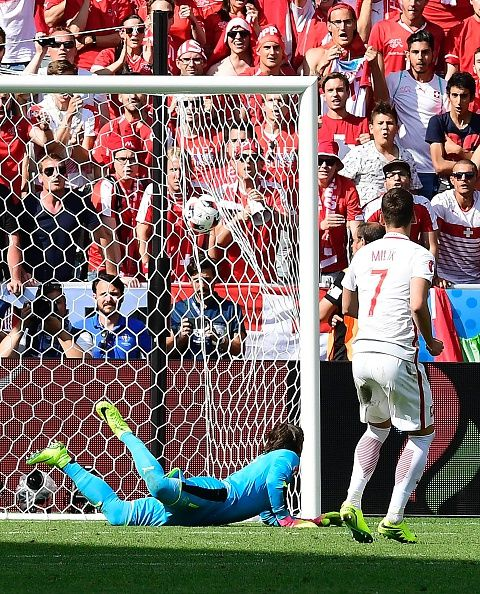 #EURO2016 Poland's forward Arkadiusz Milik converts his penalty shot during the Euro 2016 round of sixteen football match Switzerland vs Poland on June 25 2016...