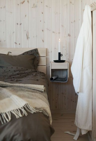 My, that looks cozy. After growing up in a home with wood panel walls, I never thought I'd want them, but this pine paneled wall looks so pretty.