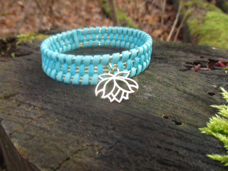 Turquoise hand woven bracelet with Gold Lotus charm by StayingGrounded on Etsy