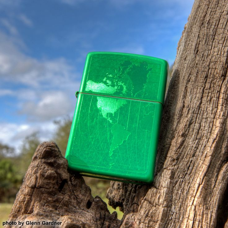 This Meadow™ lighter Zippo windproof lighter has an intricate engraving under the green of the world. Comes packaged in an environmentally friendly gift box. For optimal performance, use with Zippo premium lighter fluid.