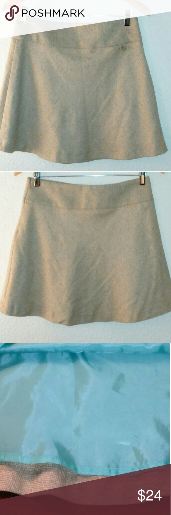 """GAP STRETCH WOOL BLEND MINI SKIRT Size 4 Attractive Beige with Turquoise Speckles Stretch Mini Skirt with Turquoise Blue Lining. It has a side Zipper and Front Button Pocket. It is New with Tags and never been worn. It is a wool blend, Shell is 58% Wool,  22% Polyester, 11% Acrylic, 8% Nylon,  1% Spandex. Lining is 100% Polyester.  Approximate Measurements:  Size 4 Waist-15"""" Length-17.5"""" Bottom Hem-27"""" Gap Skirts Mini"""