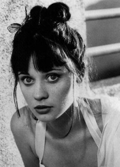 Zooey Deschanel she is a classic beauty. Could've almost a hundred years ago and would've been famous then too!