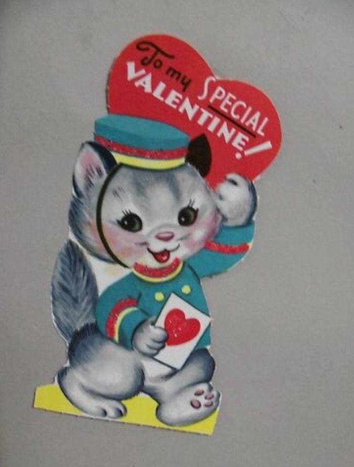Vintage Valentine kitten in bellboy outfit.