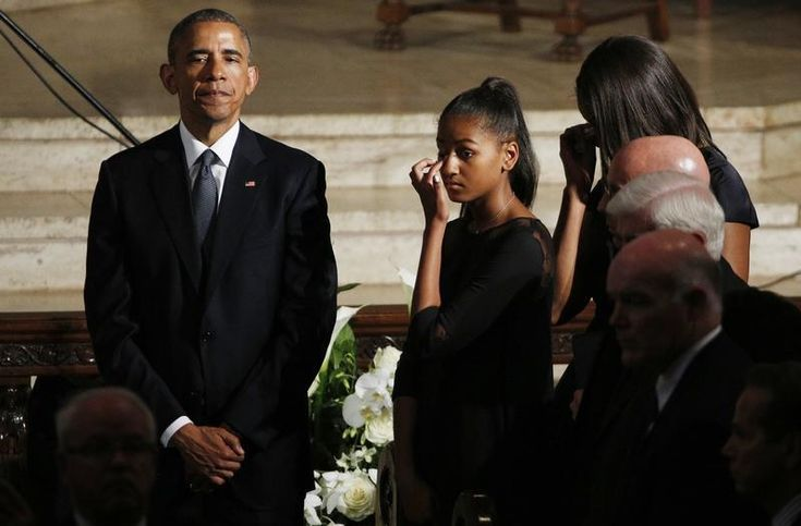 U.S. President Obama watches the casket of former Delaware Attorney General Beau Biden, son of Vice President Biden, leave his funeral in Wilimington, Delaware