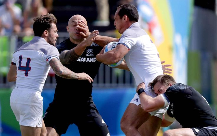 DJ Forbes of New Zealand takes a hand to the face from Damien Cler of France during a rugby sevens match at Deodoro Stadium in the Rio 2016 Summer Olympic Games.     -  Best images from Aug. 11 at the Rio Olympics