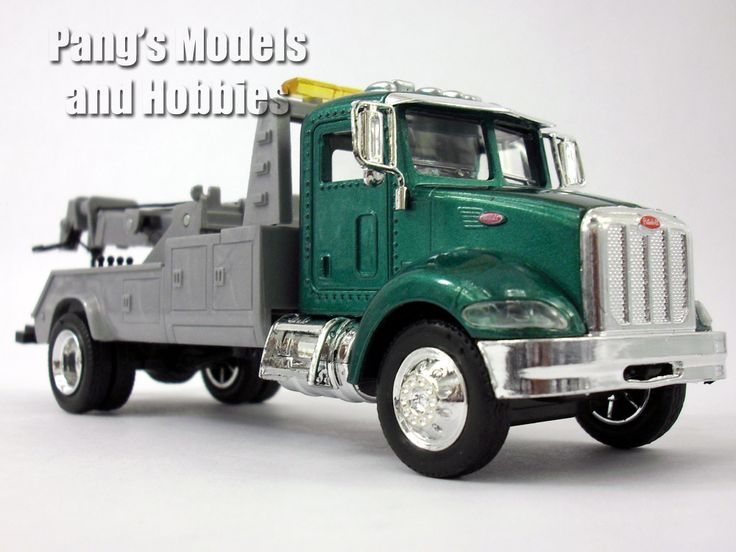 """This is a Peterbilt 335 roll off platform truck model at 1/43 scale model. It measures approximately 8.5"""" long x 2.25"""" wide x 3"""" high The cab is die-cast metal. The frame and details are made of plast"""