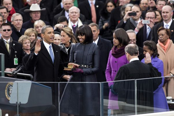 Supreme Court Chief Justice John Roberts administers the oath of office to President Barack Obama during the inaugural swearing-in ceremony at the U.S. Capitol in Washington, D.C., Jan. 21, 2013. First Lady Michelle Obama, holding a Bible that belonged to Dr. Martin Luther King Jr., and the Lincoln Bible, and daughters Malia and Sasha stand with the President.