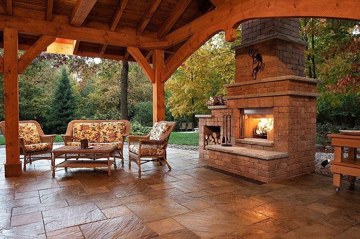 wood and stone backyard covered patio and fireplace reminds me of texas hill country type living. Black Bedroom Furniture Sets. Home Design Ideas