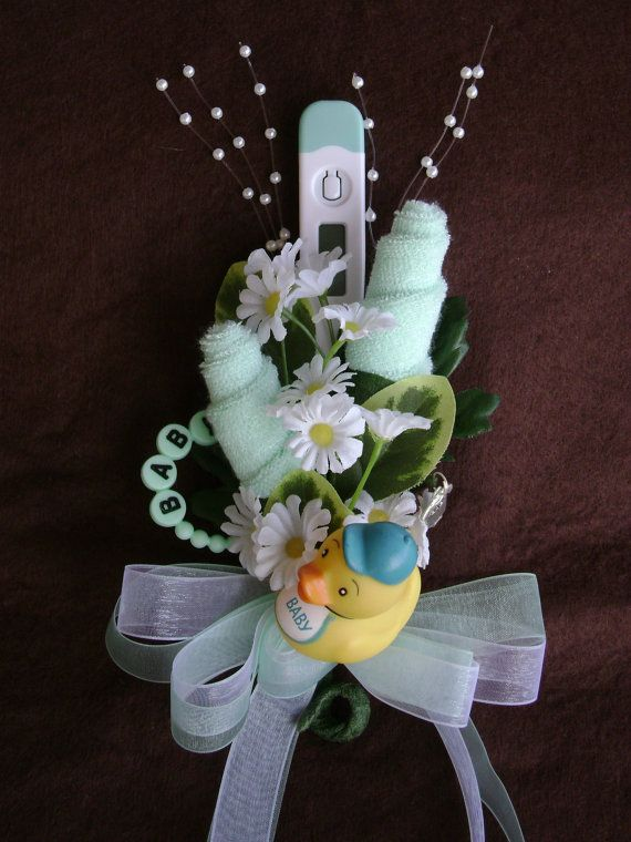 Its a corsage that can be used over and over! Disassemble the corsage after the shower and the new mom will have 2 mint green washcloths, a ducky for