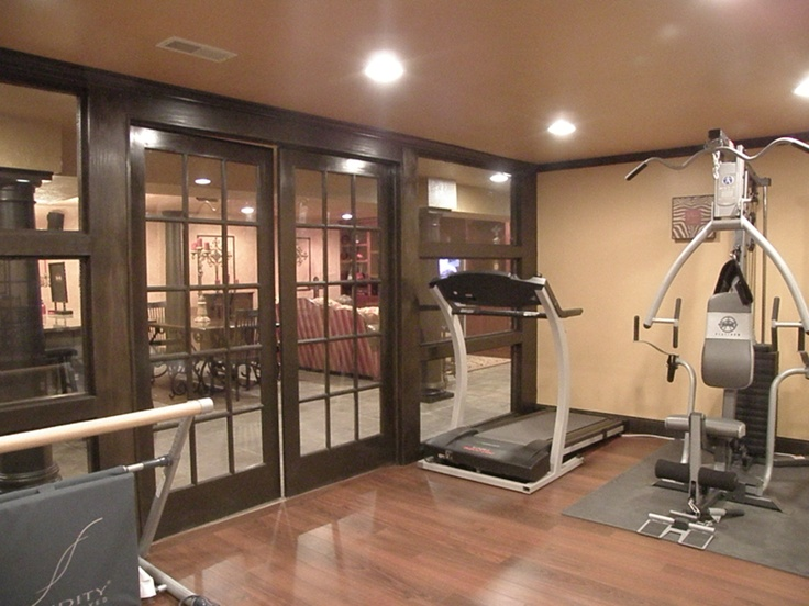 Workout room in custom basement by remarkablerd man