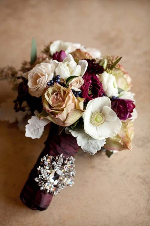 The Bridesmaids Bouquets Will Be Clutches Of Beige Roses